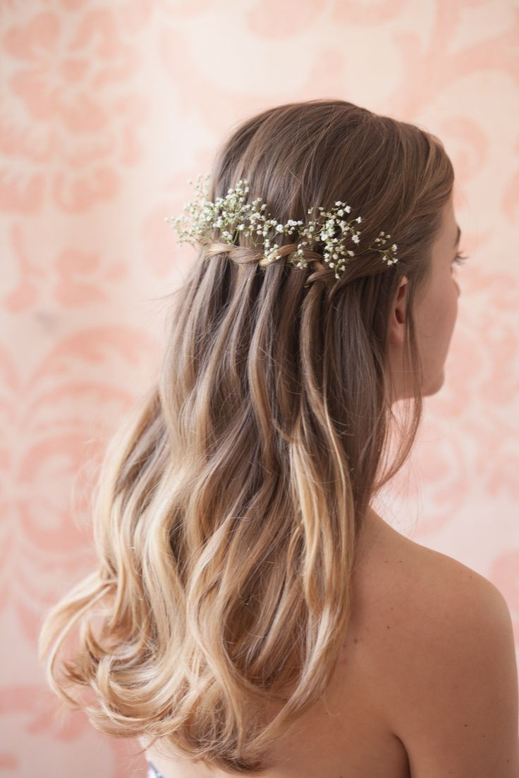 A waterfall braid with flowers in it would really look nice.