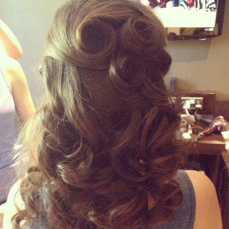 Half up half down vintage wedding hairstyle. I like how it allows for the pin cu...