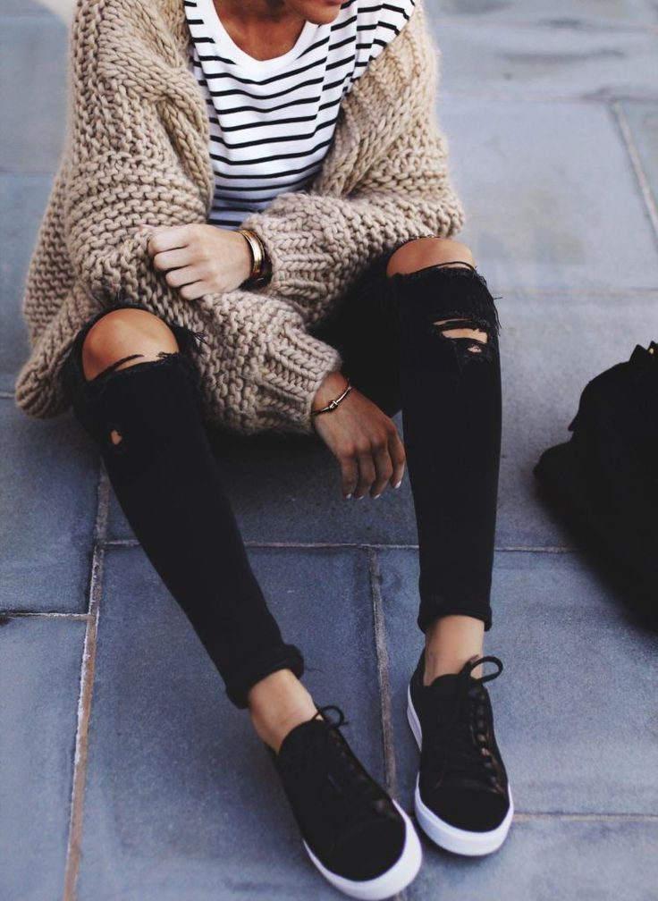 chunky knit cardigan, striped top, ripped skinnies, black sneakers street style