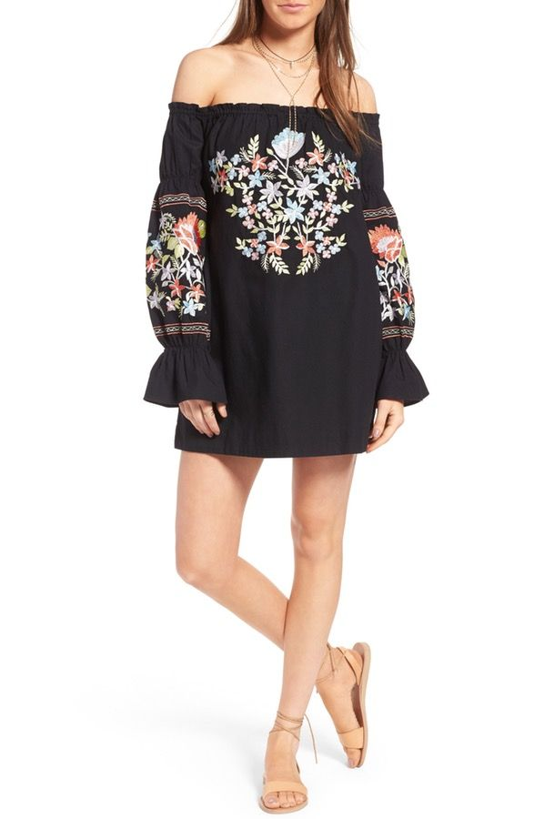Embroidered with a summer-inspired floral design, this off the shoulder mini dre...