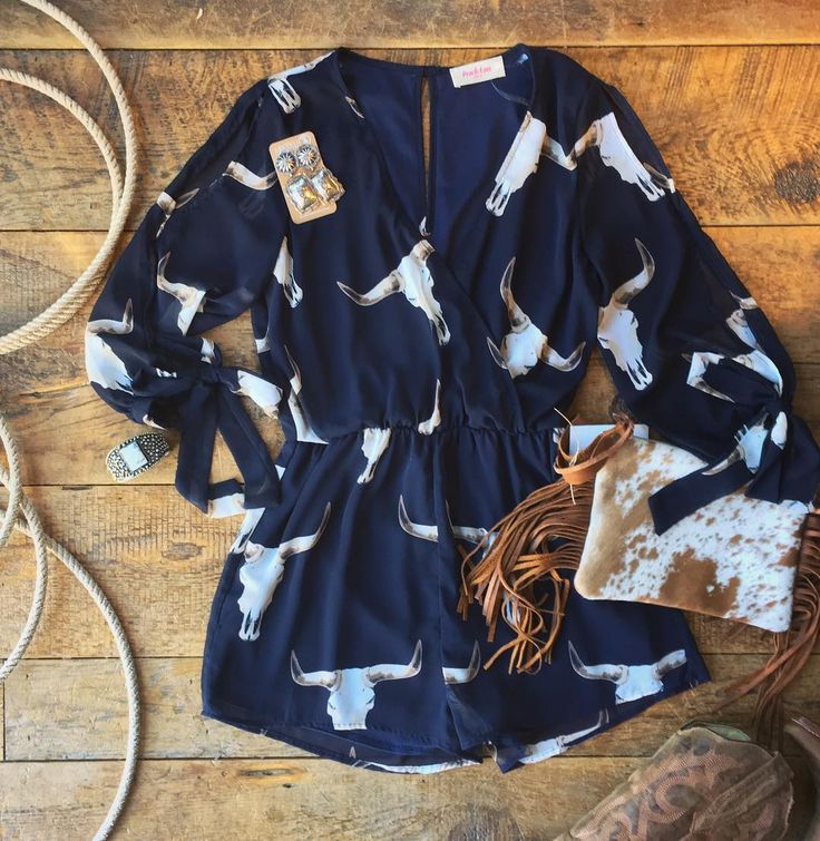 Oh. My. Goodness. This romper! #newarrival #steerskull #cowhide #perfection #sav...