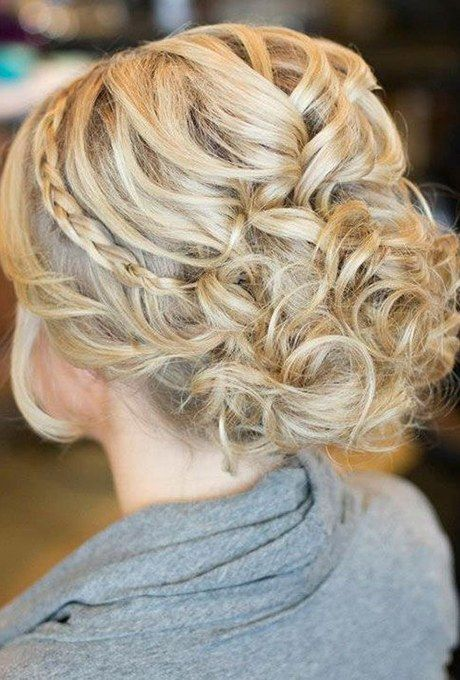 Adorning your classic curled updo with a thin braid adds a glamorous touch.