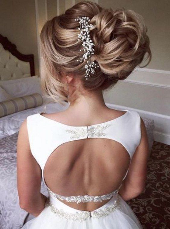 pulled back updo wedding hairstyle with chic white hair vine accessory via elsti...