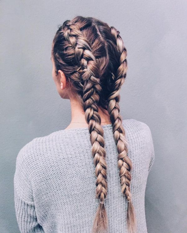 Separate your hair into two parts; then create two dutch braids right to the bot...