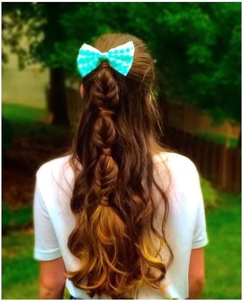 Bubble fishtail braid with a bow.