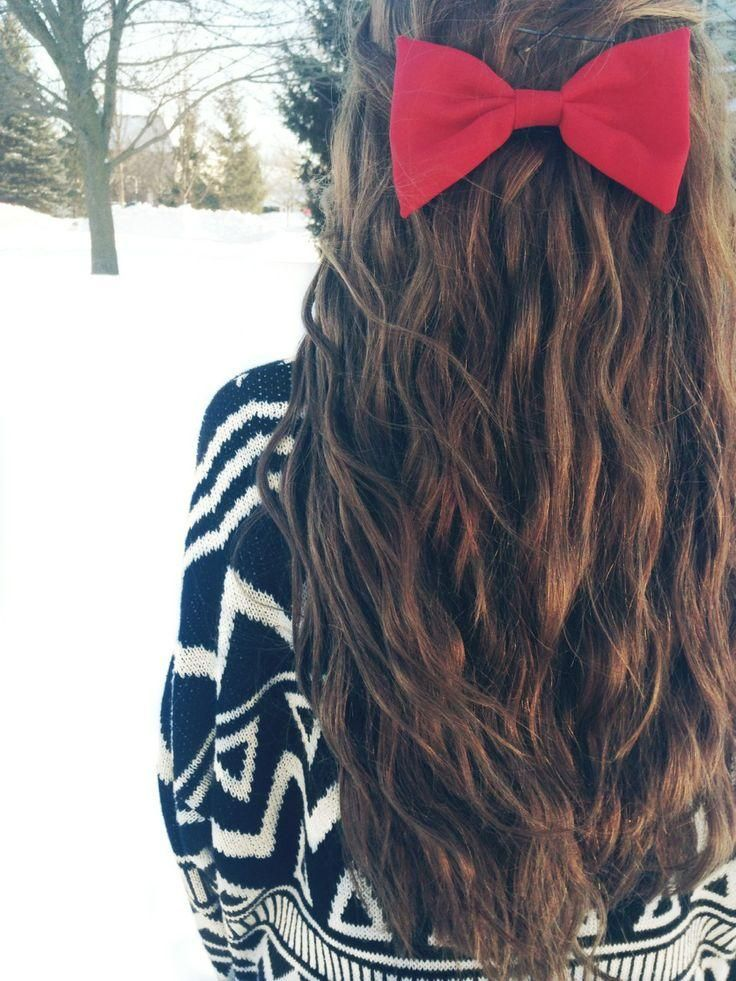 Long hair, soft waves with a red bow