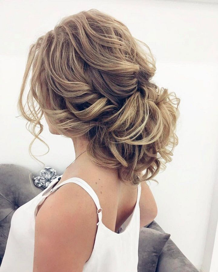 Beautiful messy updo wedding hairstyle for romantic brides. Get inspired by this...
