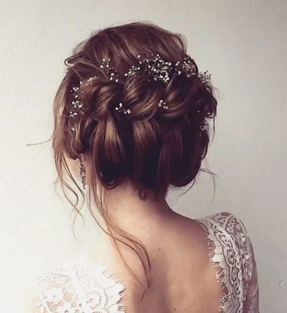 messy twisted updo wedding hairstyle with dainty hair accessories via ulyana ast...
