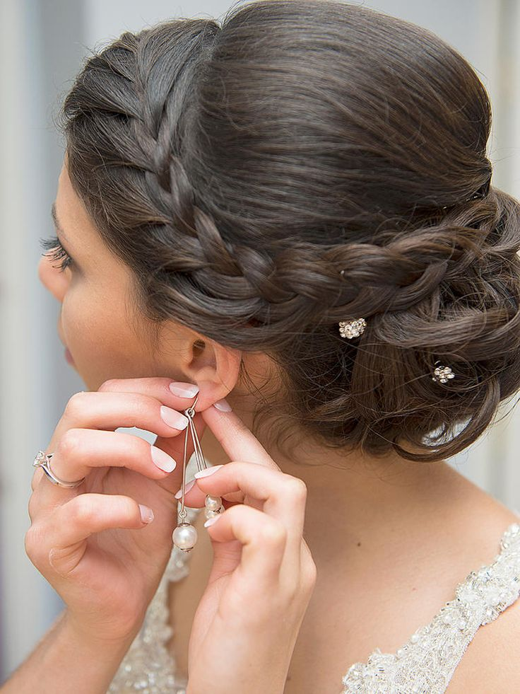 Opt for a beautiful yet simple wedding hairstyle like this sideswept French brai...