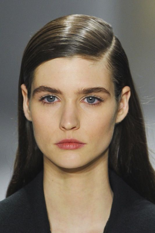 Stick straight hair with a deep side part