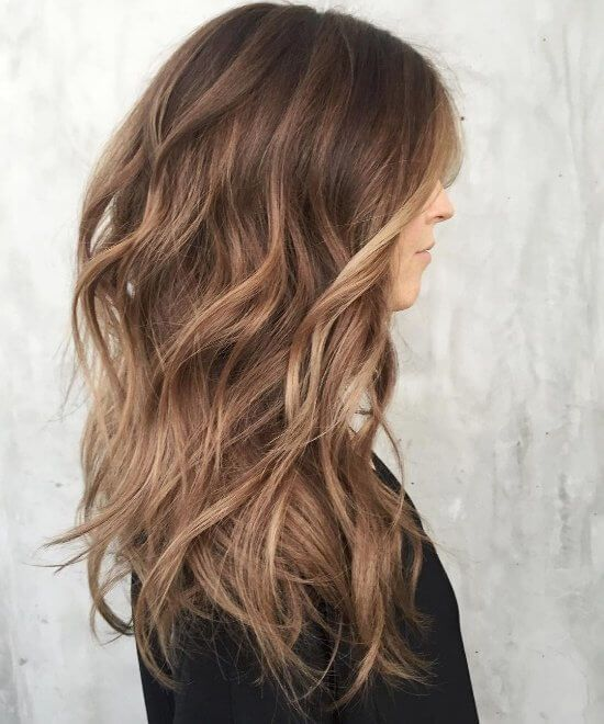 Halfway between blonde and brown, this caramel hair color adds bounce and body t...
