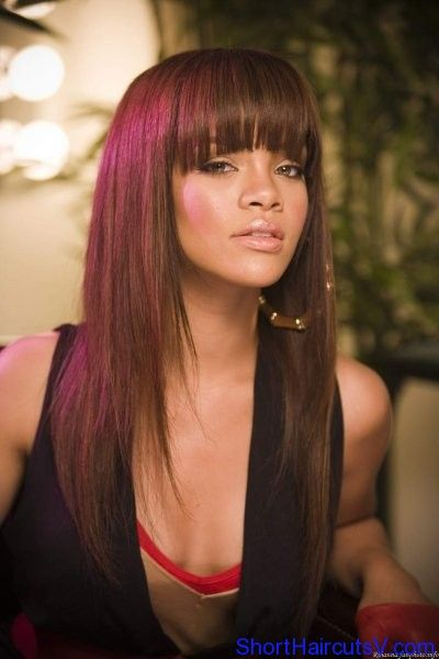 Rihanna with aubergine hair, bangs and long layers