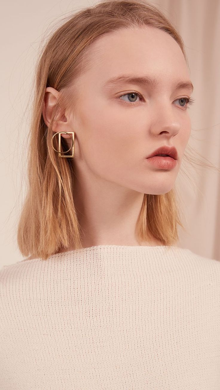 The Leya, a pair of mix-match sculptural gold-plated earring. Post back. COMPOSI...