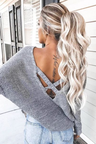 A high ponytail with beachy waves is absolutely Instagram-worthy!
