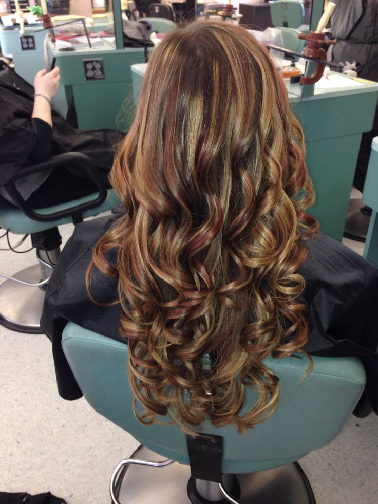 Curled hair with blonde and red highlights and brown low lights