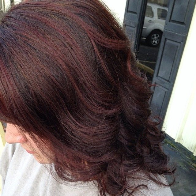Red lowlights with peekaboo caramels throughout!
