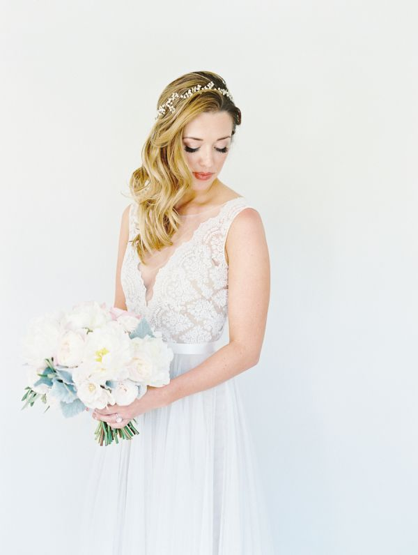 beach lace and tulle wedding dress and vintage wedding hairstyle