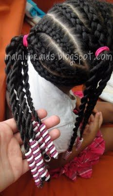 Side braids in different directions in ponytails with beads on ends by stylist
