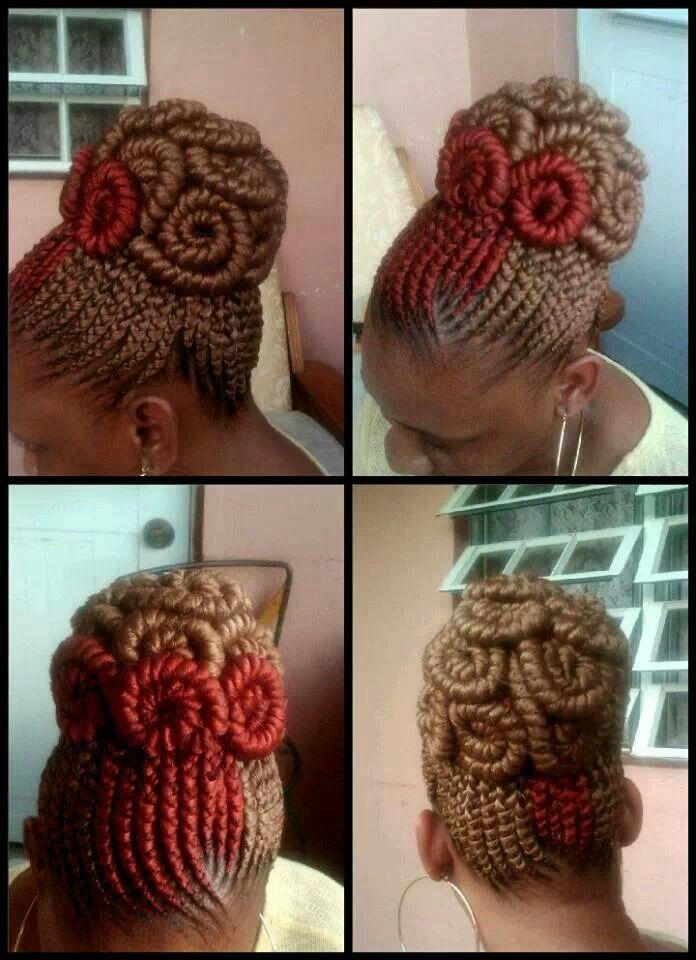 Swirled cornrow updo.  I usually really dislike yarn braids on anybody, but this...
