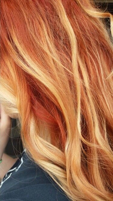 Red hair with blonde highlights.                                                ...
